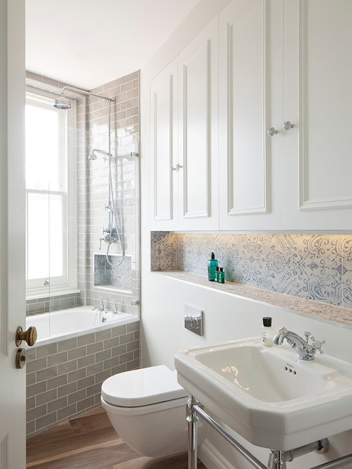 Ornate Porcelain Tile Medium Tone Wood Floor Bathroom Photo In London With  A Console Sink,