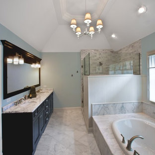 Inspiration for a mid-sized traditional master bathroom in Chicago with a drop-in tub, a corner shower, recessed-panel cabinets, dark wood cabinets, blue walls, marble floors, an undermount sink, marble benchtops and marble.
