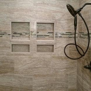 Inspiration for a large transitional master porcelain tile and beige tile porcelain floor alcove shower remodel in Other