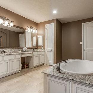 Свежая идея для дизайна: большая главная ванная комната в классическом стиле с фасадами с выступающей филенкой, белыми фасадами, накладной ванной, двойным душем, унитазом-моноблоком, бежевой плиткой, керамической плиткой, коричневыми стенами, полом из керамической плитки, врезной раковиной и столешницей из гранита - отличное фото интерьера