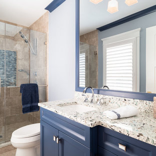 Mid-sized beach style kids' beige tile and marble tile marble floor and beige floor bathroom photo in Philadelphia with recessed-panel cabinets, blue cabinets, a one-piece toilet, blue walls, an undermount sink, quartzite countertops, a hinged shower door and multicolored countertops