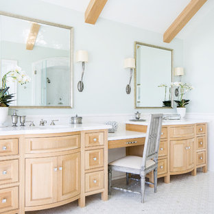 Bathroom - beach style white tile and subway tile marble floor and white floor bathroom idea in Orange County with beaded inset cabinets, medium tone wood cabinets, blue walls, an undermount sink and white countertops
