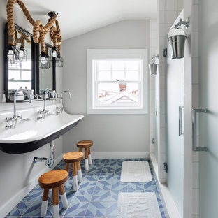 Alcove shower - beach style kids' cement tile floor and blue floor alcove shower idea in Other with gray walls, a trough sink and a hinged shower door