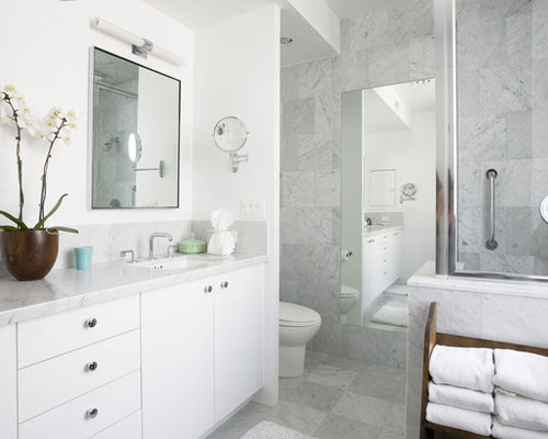 example of a trendy bathroom design in los angeles with an undermount sink - White Marble Tile Bathroom