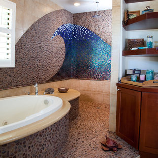 Example of a large coastal master mosaic tile and blue tile pebble tile floor and gray floor bathroom design in San Diego with recessed-panel cabinets, dark wood cabinets, multicolored walls and solid surface countertops