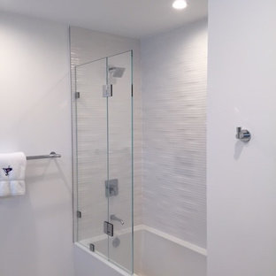 Example of a mid-sized beach style kids' white tile and ceramic tile ceramic tile bathroom design in Orlando with flat-panel cabinets, white cabinets, a one-piece toilet, white walls, an undermount sink and quartz countertops