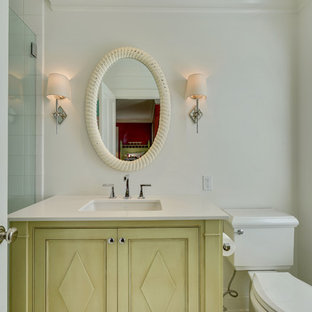 Example of a small coastal 3/4 alcove shower design in New York with beaded inset cabinets, green cabinets, white walls, an undermount sink and white countertops