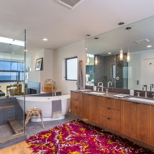 Bathroom - mid-sized eclectic master gray tile and mosaic tile light wood floor and brown floor bathroom idea in Los Angeles with flat-panel cabinets, medium tone wood cabinets, white walls, an undermount sink, quartz countertops, a hinged shower door and gray countertops