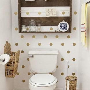 Imagen de cuarto de baño principal, de estilo zen, con lavabo de seno grande, armarios abiertos, puertas de armario marrones, encimera de mármol, jacuzzi, ducha esquinera, sanitario de una pieza, baldosas y/o azulejos negros y paredes beige