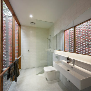 Inspiration for a small contemporary master bathroom in Melbourne with a one-piece toilet, white tile, ceramic tile, ceramic floors, a wall-mount sink, grey floor, an open shower and a curbless shower.