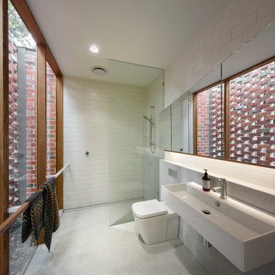 Inspiration for a small contemporary master white tile and ceramic tile ceramic tile and gray floor bathroom remodel in Melbourne with a one-piece toilet and a wall-mount sink