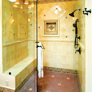 Design ideas for a medium sized mediterranean ensuite bathroom in Albuquerque with a double shower, yellow tiles, ceramic tiles, yellow walls and terracotta flooring.
