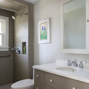 Example of a small transitional 3/4 brown tile and subway tile white floor bathroom design in Bridgeport with shaker cabinets, brown cabinets, a one-piece toilet, white walls, an undermount sink and quartzite countertops