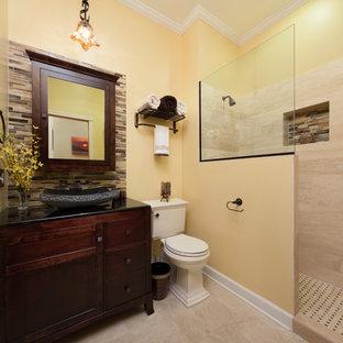 シカゴの中くらいのトランジショナルスタイルのおしゃれなバスルーム (浴槽なし) (フラットパネル扉のキャビネット、濃色木目調キャビネット、アルコーブ型シャワー、分離型トイレ、ガラスタイル、黄色い壁、セラミックタイルの床、ベッセル式洗面器、御影石の洗面台、ベージュのタイル、茶色いタイル) の写真