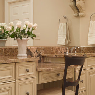 Bathroom - traditional bathroom idea in DC Metro with recessed-panel cabinets and beige cabinets