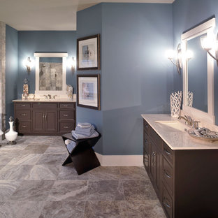 Inspiration for a contemporary gray tile brown floor bathroom remodel in Columbus with an undermount sink, recessed-panel cabinets and dark wood cabinets