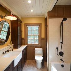 Farmhouse Bathroom by Brett Marlo Design Build