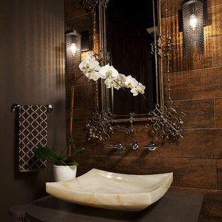 Transitional bathroom photo in Minneapolis with a vessel sink, brown walls and brown countertops