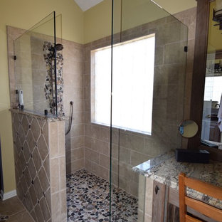 Small arts and crafts master beige tile and ceramic tile ceramic floor corner shower photo in Atlanta with a vessel sink, furniture-like cabinets, medium tone wood cabinets, granite countertops and yellow walls
