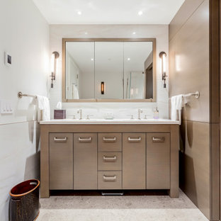 Mid-sized trendy 3/4 white tile and porcelain tile gray floor corner shower photo in New York with flat-panel cabinets, brown cabinets, a wall-mount toilet, white walls, an undermount sink and white countertops