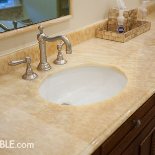 Example of a large trendy bathroom design in New York with onyx countertops