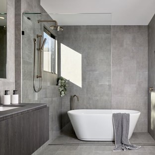 Inspiration for a modern master bathroom in Brisbane with flat-panel cabinets, grey cabinets, a freestanding tub, gray tile, an undermount sink, grey floor and grey benchtops.