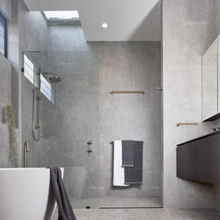 Modern bathroom in Brisbane with flat-panel cabinets, grey cabinets, a freestanding tub, an alcove shower, gray tile, grey floor, an open shower and grey benchtops.