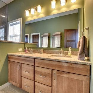 Ejemplo de cuarto de baño de estilo americano con lavabo encastrado, armarios con paneles empotrados, puertas de armario de madera clara, encimera de granito, ducha esquinera, baldosas y/o azulejos marrones, baldosas y/o azulejos de cemento y paredes verdes