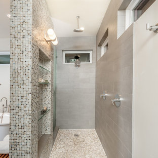 Example of a mid-sized transitional gray tile and porcelain tile pebble tile floor bathroom design in Dallas with an undermount sink and beige walls