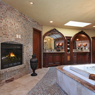 Huge tuscan master multicolored tile and mosaic tile porcelain floor corner shower photo in Orange County with furniture-like cabinets, dark wood cabinets, a hot tub, beige walls, an undermount sink and granite countertops