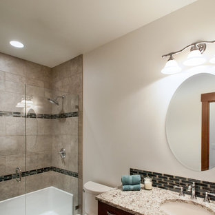 Example of a mid-sized arts and crafts gray tile and ceramic tile ceramic tile bathroom design in Seattle with shaker cabinets, dark wood cabinets, white walls, an undermount sink and marble countertops