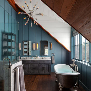 Inspiration for a farmhouse medium tone wood floor and brown floor claw-foot bathtub remodel in San Francisco with shaker cabinets, gray cabinets, blue walls, an undermount sink, a hinged shower door and white countertops