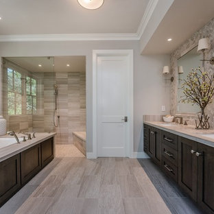 Photo of a large country master bathroom in San Francisco with shaker cabinets, dark wood cabinets, an undermount tub, a curbless shower, gray tile, grey walls, an undermount sink, grey floor, an open shower, a one-piece toilet, ceramic tile, engineered quartz benchtops and porcelain floors.