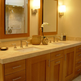 Trendy bathroom photo in San Francisco with an undermount sink, shaker cabinets and medium tone wood cabinets
