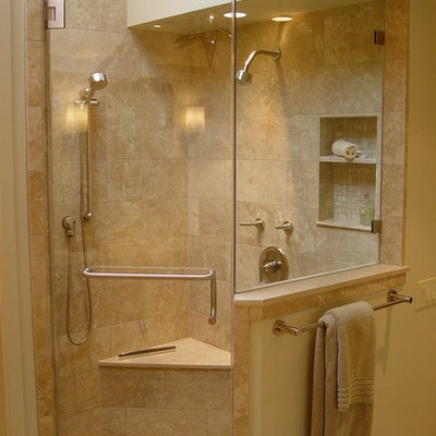 Example of a trendy travertine tile corner shower design in San Francisco