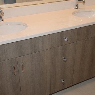 Example of a trendy bathroom design in Chicago with gray cabinets and an undermount sink