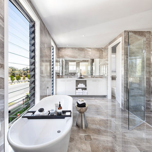 Inspiration for a contemporary master bathroom in Brisbane with flat-panel cabinets, white cabinets, a freestanding tub, a curbless shower, brown tile, an undermount sink, brown floor and a hinged shower door.