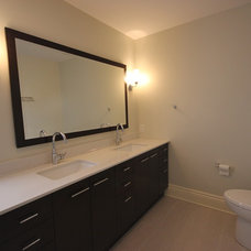 Traditional Bathroom by OakWood Renovation Experts