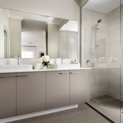Inspiration for a contemporary beige tile and gray tile bathroom remodel in Perth with flat-panel cabinets, gray cabinets, white walls and a vessel sink