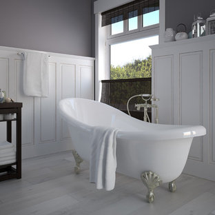 Large victorian master bathroom in Philadelphia with raised-panel cabinets, white cabinets, a claw-foot tub, grey walls, light hardwood floors and grey floor.