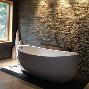 Bathroom - large industrial master black tile and porcelain tile bamboo floor bathroom idea in Other with a two-piece toilet, white walls, a trough sink and concrete countertops