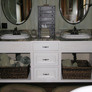Inspiration for a large craftsman master bathroom remodel in Minneapolis with a drop-in sink, open cabinets, white cabinets, granite countertops and multicolored walls