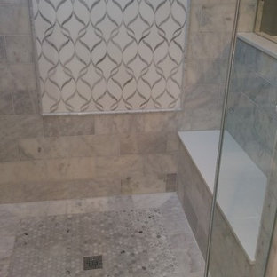 Large minimalist master white tile and marble tile mosaic tile floor and white floor bathroom photo in Chicago with flat-panel cabinets, white cabinets, a two-piece toilet, gray walls, an undermount sink, quartz countertops and a hinged shower door
