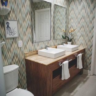 Immagine di una stanza da bagno minimal con lavabo a bacinella, ante lisce, ante in legno scuro, pareti multicolore, top in onice e pavimento in gres porcellanato