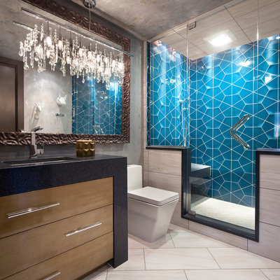 Alcove shower - contemporary 3/4 blue tile beige floor alcove shower idea in Other with flat-panel cabinets, medium tone wood cabinets, gray walls and black countertops