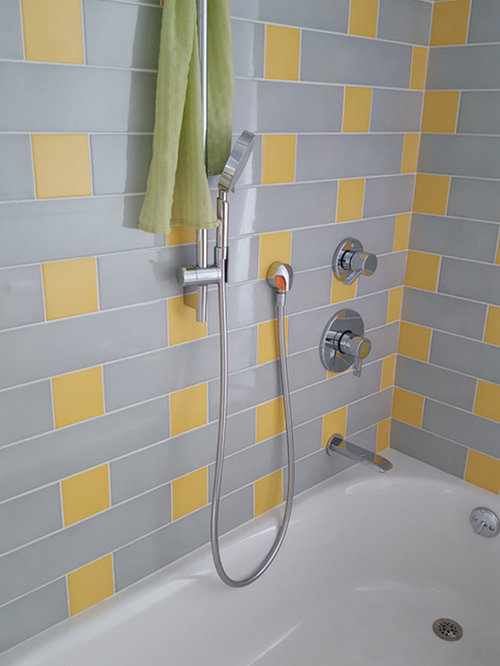 example of a large transitional gray tile yellow tile and porcelain tile bathroom design in