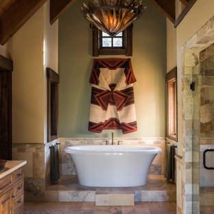 Bathroom - large rustic master beige tile and travertine tile slate floor and multicolored floor bathroom idea in Sacramento with furniture-like cabinets, beige walls, a vessel sink, medium tone wood cabinets, granite countertops and a hinged shower door