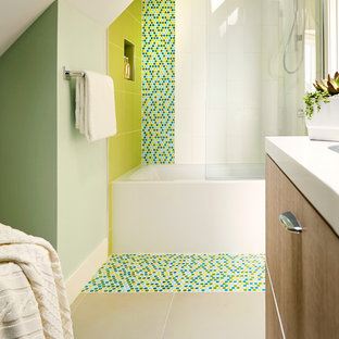 Mid-sized trendy master white tile and stone slab ceramic tile bathroom photo in San Francisco with flat-panel cabinets, medium tone wood cabinets, a one-piece toilet, green walls, a drop-in sink and solid surface countertops