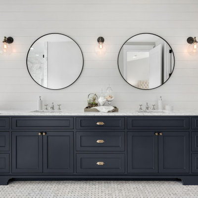 Inspiration for a large transitional master gray floor bathroom remodel in Houston with marble countertops, shaker cabinets, blue cabinets, white walls, an undermount sink and white countertops