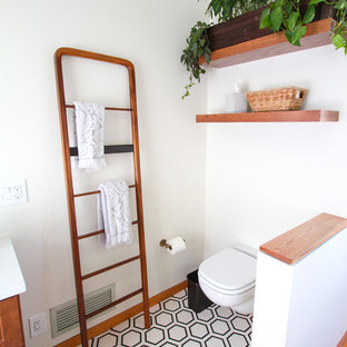 Small transitional 3/4 white tile and subway tile porcelain tile and white floor bathroom photo in Philadelphia with flat-panel cabinets, medium tone wood cabinets, a one-piece toilet, white walls, an undermount sink, quartzite countertops and white countertops